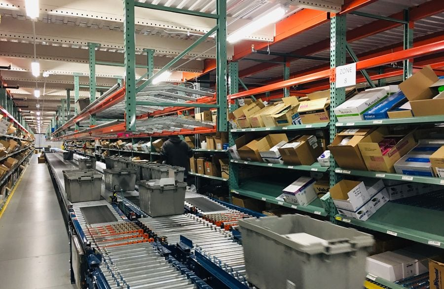 goods travel by conveyor belt at a warehouse fulfillment