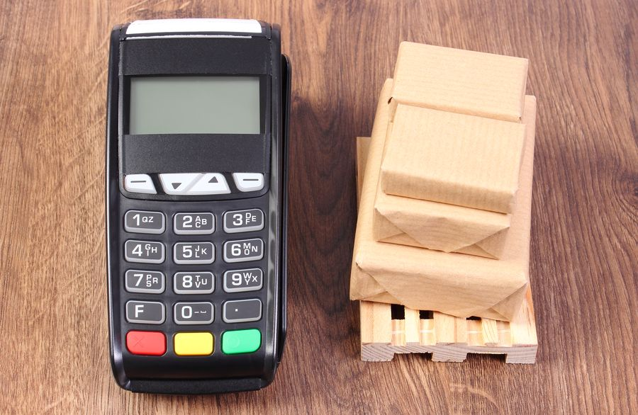 payment terminal and boxes on wooden pallet